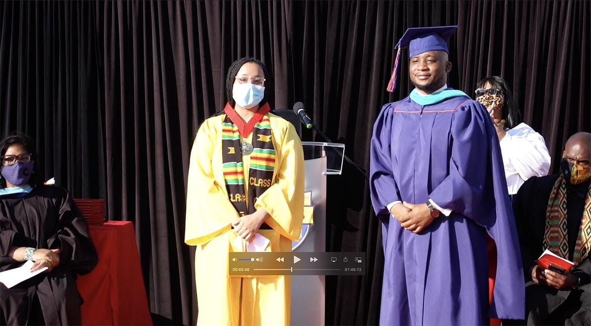 Principle of AIMS Mr Maurice Williams with Valedictorian Zewditu Herring AIMS High School Drive In Graduation